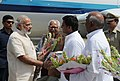 Narendra Modi being received by the Governor of Uttar Pradesh, Shri Ram Naik and the Chief Minister of Uttar Pradesh, Shri Akhilesh Yadav, on his arrival at Varanasi, Uttar Pradesh on September 18, 2015.jpg