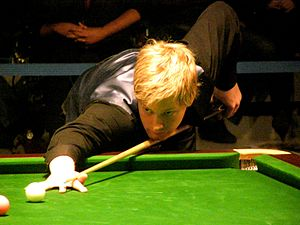 Neil Robertson playing a shot on the pink ball.