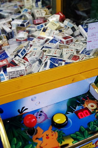 Nicotine marketing - Cigarettes in a Pokémon-cartoon-branded claw crane arcade game in 2008 in Jaffa, Israel.