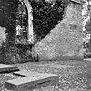 noordgevel met doorgang van 2 meter in tufsteen en een later poortje in baksteen - baflo - 20027379 - rce