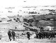 The build-up of Omaha Beach: reinforcements of men and equipment moving inland