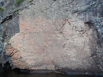 Bon Echo Provincial Park - OLD WALT carving as it appears on July 24, 2014, almost 95 years after completion.