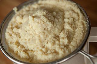 Filtering okara from a fresh batch of homemade soymilk.