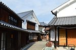 Wooden houses with white walls.