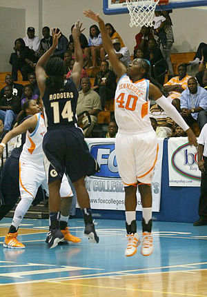 Georgetown Hoyas women's basketball - Georgetown's Sugar Rodgers shoots over Tennessee's Shekinna Stricklen at the 2010 Paradise Jam