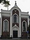 foto van Kerk voor de Evangelische Broedergemeente, opgetrokken in baksteen, naar eclectisch ontwerp