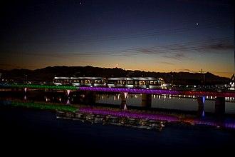 Valley Metro Rail - Phoenix light rail at night on Tempe Town Lake, 2008