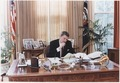Photograph of President Reagan working at his Oval Office desk - NARA - 198526.tif