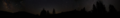 Photoshoped panoramic view of forest at night.png
