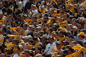A large crowd of Steelers fans with golden towels