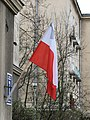 Polish flag with black mourning ribbon.jpg