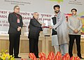 """Pranab Mukherjee presenting the Rajat Kamal Award for Best AudioGraphy of the film """"Tender is the Sight"""" in Non Feature Films Section to the Audiographer, Shri Ateesh Chattopadhyay, at the 62nd National Film Awards Function.jpg"""