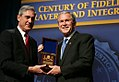 President George W. Bush is presented with an honorary FBI Special Agent credential by FBI Director Robert Mueller.jpg