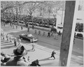 President Truman and Vice President Alben Barkley ride in their limousine to the reviewing stand for the inaugural... - NARA - 200039.tif