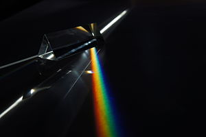 Photonics - Dispersion of light (photons) by a prism.