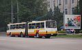 Pyongyang trolleybus 140 in white-yellow-red livery, side and rear view.jpg