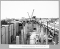 Queensland State Archives 3712 South approach column construction and erection of concrete hopper and runway for concreting deck Brisbane 23 October 1936.png