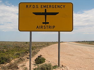 Highway strip - A sign on the Eyre Highway in Australia indicating that an RFDS emergency airstrip is ahead. There are four such strips on the highway.