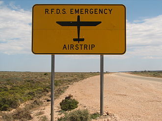 Royal Flying Doctor Service of Australia - A sign on the Eyre Highway indicating that an RFDS emergency airstrip is ahead. There are four such strips on the highway.