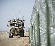 No. 51 Squadron RAF Regiment Foxhound vehicle on patrol at the perimeter of Camp Bastion, Afghanistan in 2014.