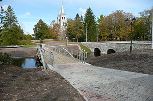 Rapla - Bridges over Vigala River. Rapla church in the background.