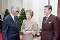 Reagan and Lew Wasserman standing in Cross Hall during Reception and Presentation of Congressional Medal to Lady Bird Johnson C46731-14.jpg