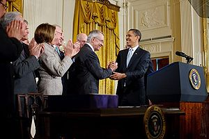Harry Reid - President Barack Obama shakes hands with Reid after signing the Omnibus Public Lands Management Act of 2009 on March 30, 2009.