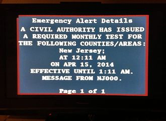 Emergency Alert System - A Required Monthly Test (RMT) transmitted in New Jersey on April 15, 2014 as shown on a television set.