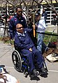 Retired U.S. Navy Boatswain's Mate 1st Class Jim Castaneda, seated, accompanied by Hospital Corpsman 3rd Class Angelo Anderson, carries the torch during the opening ceremony for the 2013 Warrior Games 130511-N-QD949-002.jpg