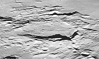 Rhaeticus (crater) - Oblique view of Rhaeticus facing west at low sun angle.  From Apollo 10
