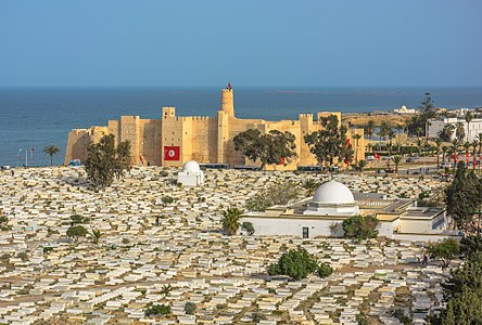 View of the Ribat of Monastir, in Tunisia. This medieval fortress, built in the end of the 8th century AD, is consedred as one of the oldest and biggest Ribats in North Africa. In this picture there is tow other classified monuments in Monastir and they are The Imam Mazri Mausoleum and The Amor Makhlouf Mausoleum too.