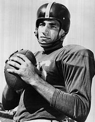 Black and white photo of Rick Casares in Florida Gators jersey and helmet (c. 1953).