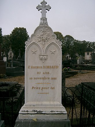 "Arthur Rimbaud - Rimbaud's grave in Charleville. The inscription reads Priez pour lui (""Pray for him"")."