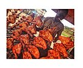 Roasted chicken seller with so much happiness.jpg