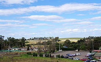 Rooty Hill, New South Wales - Rooty Hill, seen from the railway station. In the background is the hill from which the area gets its name.