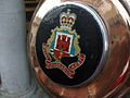 Royal Gibraltar Regiment coat of arms on end of cannon.jpg