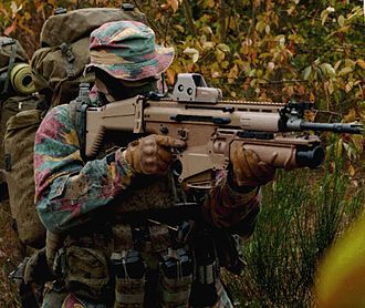Belgian Land Component - Belgian Special Forces Group operator with a FN SCAR-H rifle.