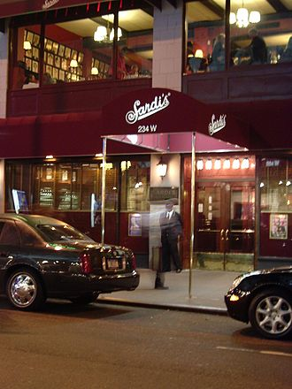 Sardi's - Sardi's Restaurant. Note the rows of caricatures visible through the upstairs windows.