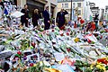 Secretary Kerry and French Foreign Minister Fabius Walk Past Flowers Laid at the Site of Shooting at the Headquarters of Charlie Hebdo (16291417492).jpg