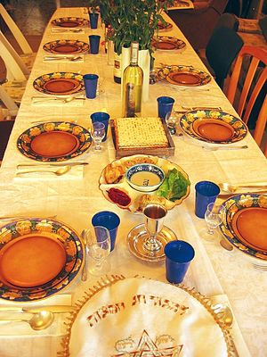 Festive Seder table with wine, matza and Seder...