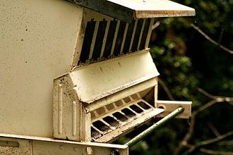 Bird feeder - An empty bird-seed dispenser