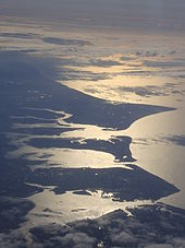 A high aerial view of Portsea Island (the island which Portsmouth is situated on), and neighbouring Hayling Island.