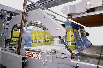 Shrink wrap - Shrink film wrap being applied on a soft drink packing line