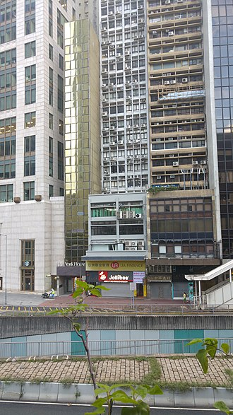 History of the Jews in Hong Kong - Shuva Israel Synagogue (the windows with green curtains on the third floor of the building in the center)
