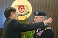 Singapore Minister of Defense Teo Chee Hean, awards the Meritorious Service Medal to the Chief of Staff of the U.S. Army, Gen. George W. Casey Jr., right, in Singapore Aug. 26, 2009 090826-A-VO565-004.jpg