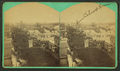 Sioux Falls showing American flag flying over street, building identified as Cataract House, by L. V. Bean.png