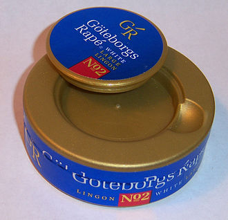 Snus - Catchlid found on many snus tins, which snaps in and out of place. The small compartment is typically used for the temporary storage of used snus portions.