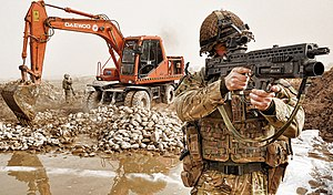 Route Trident - A soldier keeps watch during construction of Route Trident in January 2011.