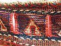 Soumak saddle bag border with slits for rope.JPG
