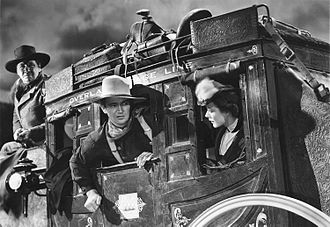 Stagecoach (1939 film) - George Bancroft, John Wayne and Louise Platt in Stagecoach (1939)